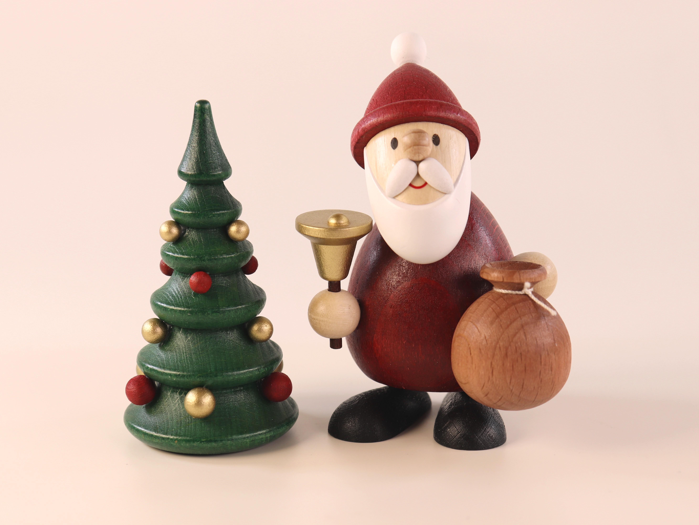 Weihnachtsmann mit Glocke, Sack und Weihnachtsbaum als Tischdeko
