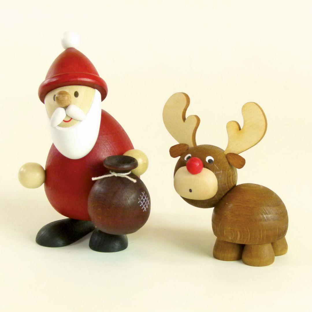 Weihnachtsmann mit Elch als Tischdeko kaufen