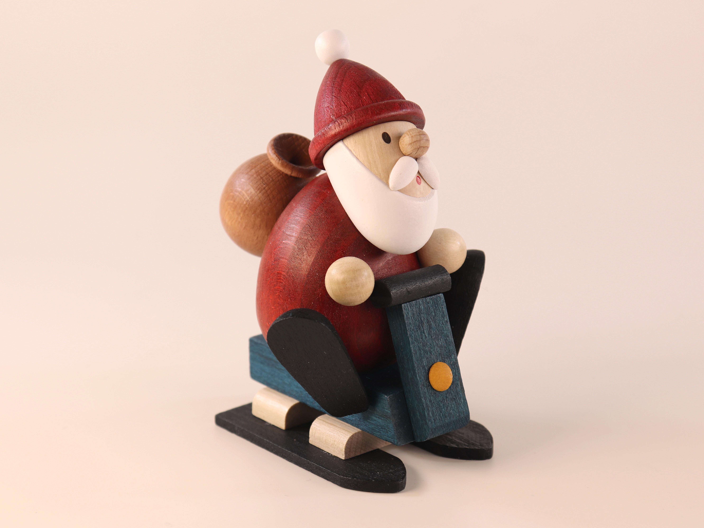 Weihnachtsmann mit Schneemobil als Tischschmuck
