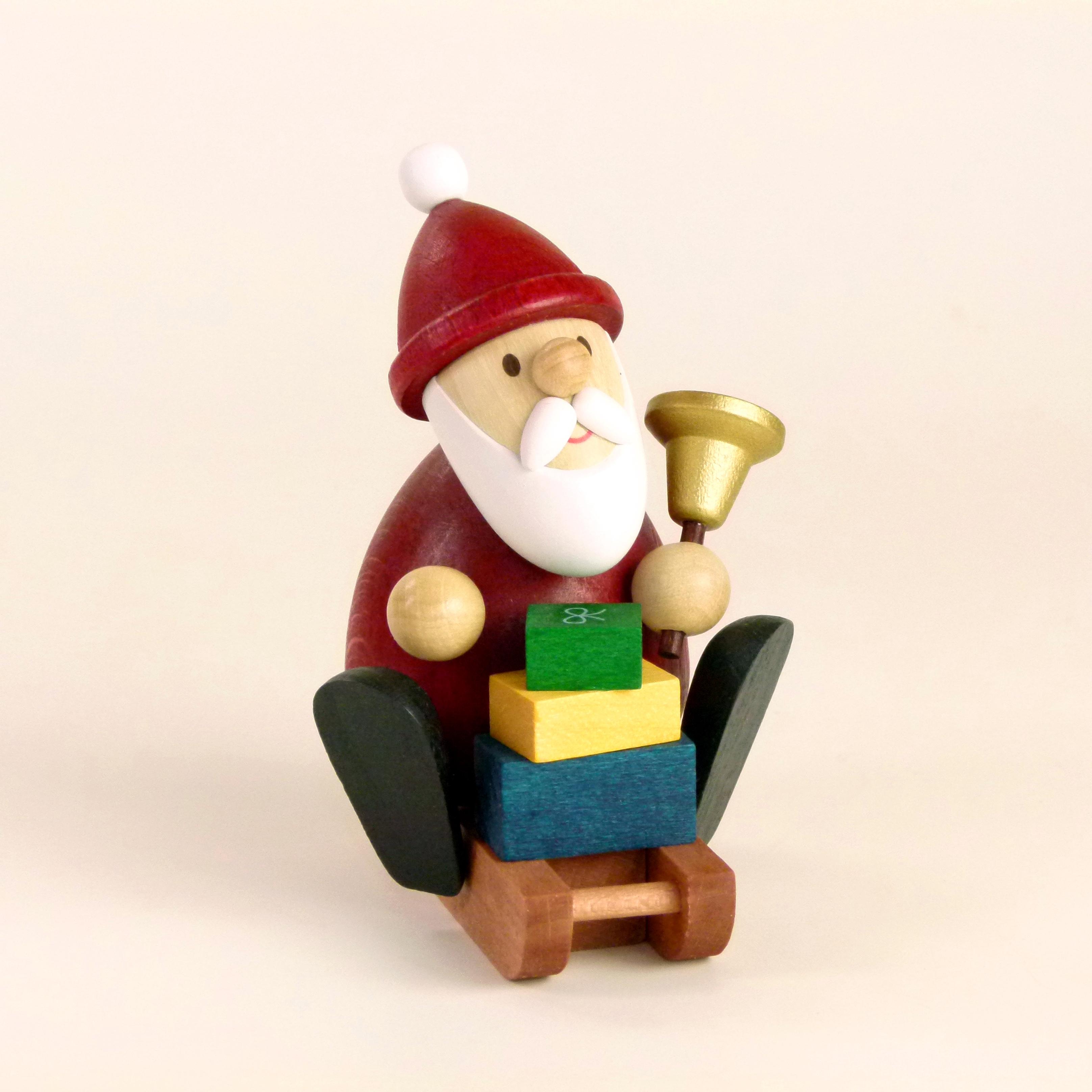 Weihnachtsdeko: Weihnachtsmann modern auf Schlitten mit Glocke